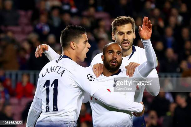 Lucas Moura of Tottenham Hotspur celebrates after scoring his team's first goal with Erik Lamela and Fernando Llorente during the UEFA Champions...