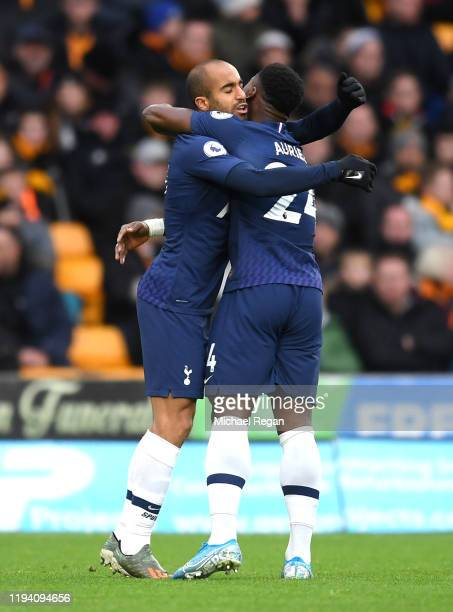 Lucas Moura of Tottenham Hotspur celebrates after scoring his team's first goal with teammate Serge Aurier during the Premier League match between...