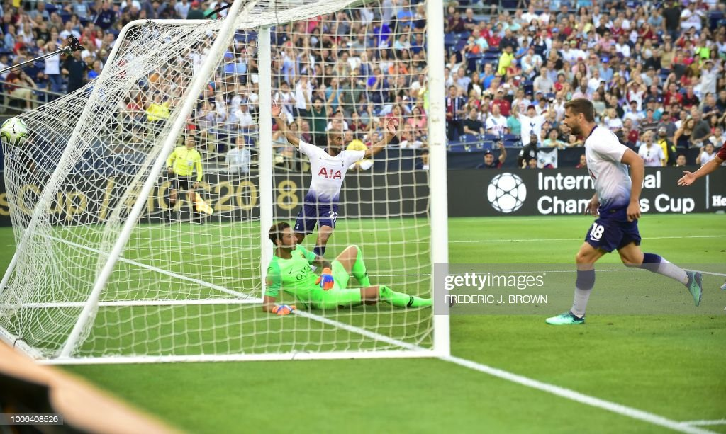 Lucas Moura of Tottenham Hotspur (C) celebrates as Fernando Llorente (R) scores on a rebound off Moura's shot against AS Roma goalkeeper Antonio Mirante in their International Champions Cup match in San Diego, California on July 25, 2018 where Tottenham defeated Roma 4-1.