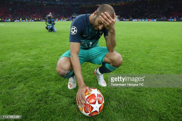 Lucas Moura of Tottenham Hotspur celebrates victory with the match ball after the UEFA Champions League Semi Final second leg match between Ajax and...