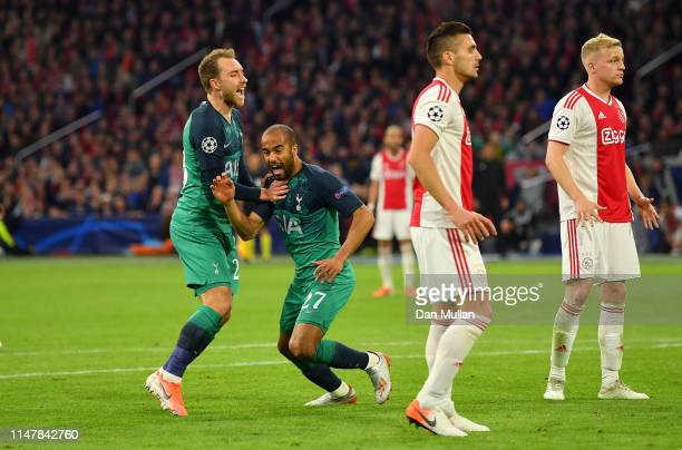 Lucas Moura of Tottenham Hotspur celebrates with Christian Eriksen of Tottenham Hotspur after he scores his sides second goal during the UEFA...