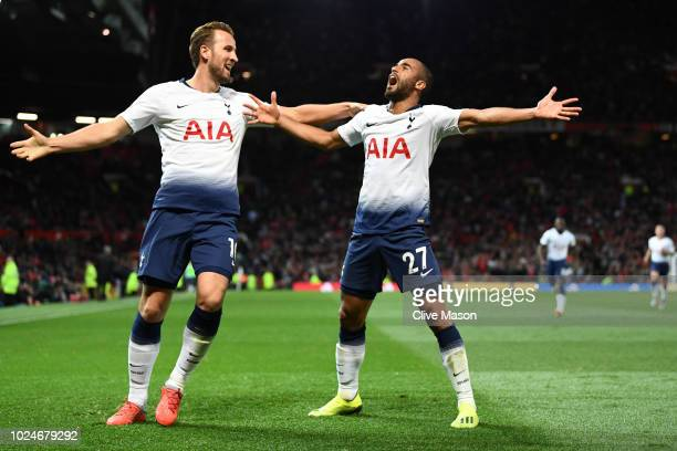 Lucas Moura of Tottenham Hotspur celebrates with Harry Kane of Tottenham Hotspur after scoring his second goal and his team's third goal during the...