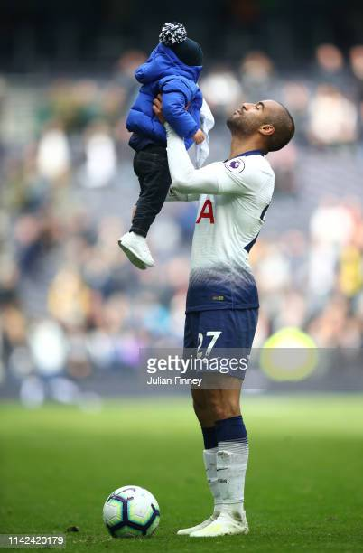 Lucas Moura of Tottenham Hotspur celebrates with his child Miguel Moura at fulltime of the Premier League match between Tottenham Hotspur and...