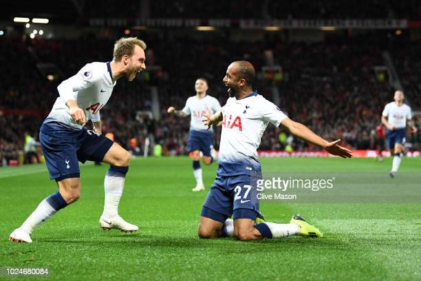 Lucas Moura of Tottenham Hotspur celebrates with team mate Christian Eriksen after scoring his team's second goal during the Premier League match...