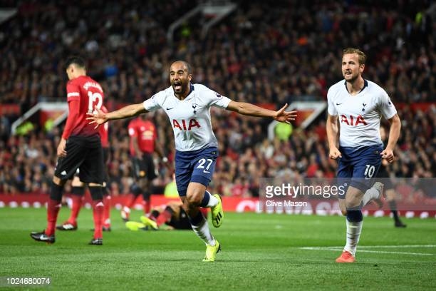 Lucas Moura of Tottenham Hotspur celebrates with team mate Harry Kane after scoring his team's second goal during the Premier League match between...