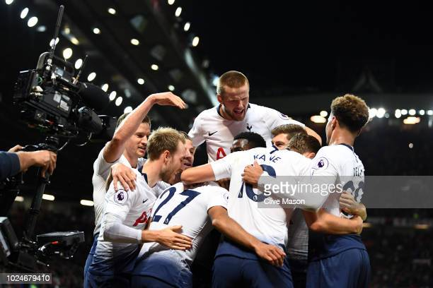 Lucas Moura of Tottenham Hotspur celebrates with team mates after scoring his second goal and his team's third goal during the Premier League match...