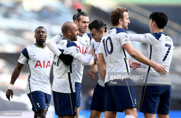 Lucas Moura of Tottenham Hotspur celebrates with team mates Gareth Bale, Sergio Reguilon, Harry Kane and Son Heung-Min after scoring their side's...