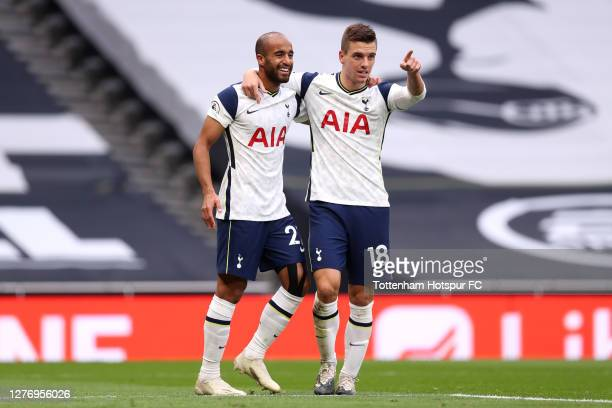 Lucas Moura of Tottenham Hotspur celebrates with teammate Giovani Lo Celso after scoring his team's first goal during the Premier League match...