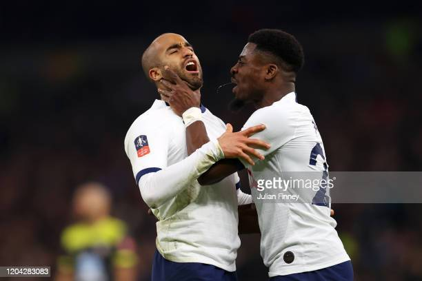 Lucas Moura of Tottenham Hotspur celebrates with teammate Serge Aurier after scoring his team's second goal during the FA Cup Fourth Round Replay...