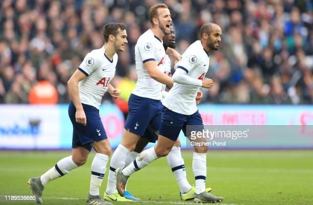 Lucas Moura of Tottenham Hotspur celebrates with teammates after scoring his team's second goal during the Premier League match between West Ham...