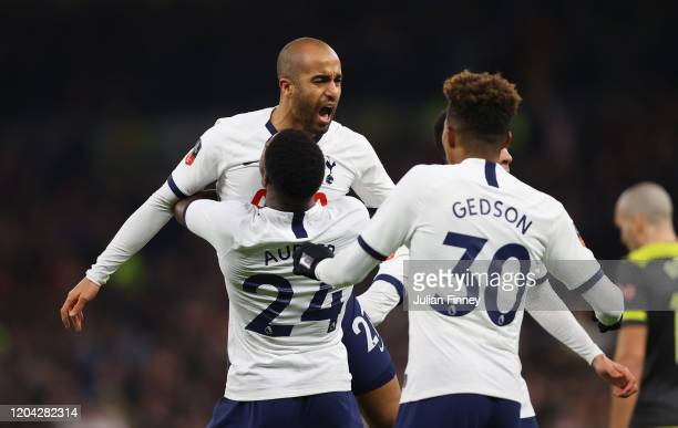 Lucas Moura of Tottenham Hotspur celebrates with teammates after scoring his team's second goal during the FA Cup Fourth Round Replay match between...