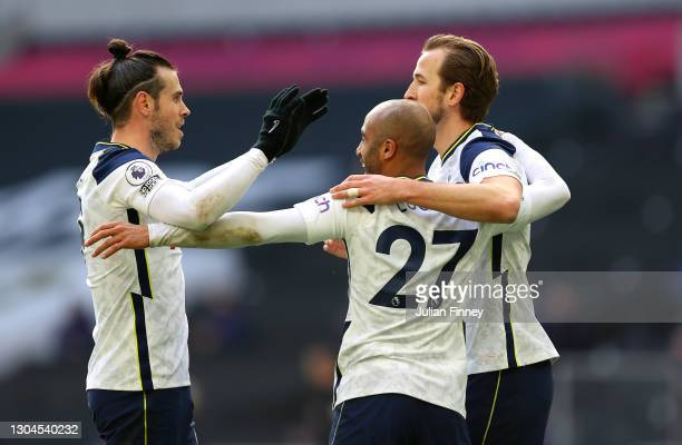 Lucas Moura of Tottenham Hotspur celebrates with teammates Gareth Bale and Harry Kane after scoring their team's third goal during the Premier League...