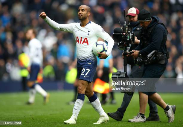 Lucas Moura of Tottenham Hotspur celebrates with the matchball at fulltime after scoring hattrick during the Premier League match between Tottenham...