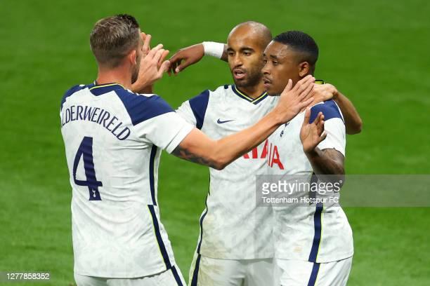 Lucas Moura of Tottenham Hotspur celebrates with Toby Alderweireld and Steven Bergwijn of Tottenham Hotspur after scoring his team's first goal...
