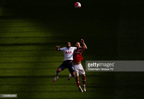 Lucas Moura of Tottenham Hotspur challenges Shkodran Mustafi of Arsenal during the Premier League match between Tottenham Hotspur and Arsenal FC at...
