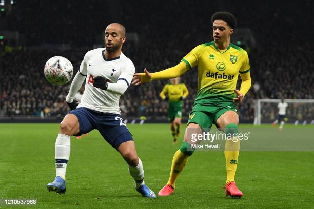 Lucas Moura of Tottenham Hotspur is challenged by Jamal Lewis of Norwich City during the FA Cup Fifth Round match between Tottenham Hotspur and...