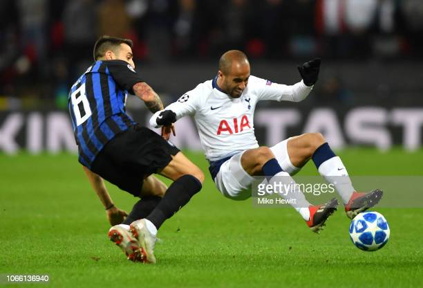 Lucas Moura of Tottenham Hotspur is challenged by Matias Vecino of Inter Milan during the UEFA Champions League Group B match between Tottenham...