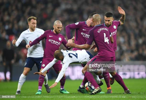 Lucas Moura of Tottenham Hotspur is fouled by Nicolas Otamendi of Manchester City David Silva of Manchester City Vincent Kompany of Manchester City...