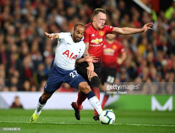 Lucas Moura of Tottenham Hotspur is tackled by Phil Jones of Manchester United during the Premier League match between Manchester United and...