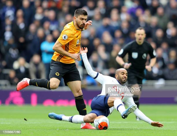 Lucas Moura of Tottenham Hotspur is tackled by Ruben Neves of Wolverhampton Wanderers during the Premier League match between Tottenham Hotspur and...