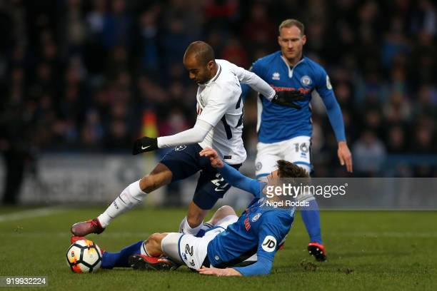Lucas Moura of Tottenham Hotspur is tackled by Ryan Delaney of Rochdale AFC during The Emirates FA Cup Fifth Round match between Rochdale and...
