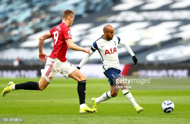 Lucas Moura of Tottenham Hotspur makes a pass whilst under pressure from Scott McTominay of Manchester United during the Premier League match between...
