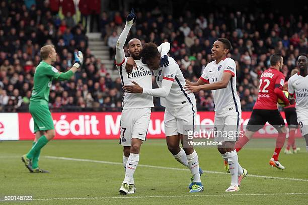 Lucas Moura Presnel Kimpempe and Christopher Alan Nkunku of Paris SaintGermain during the French League 1 match between EA Guingamp and Paris...