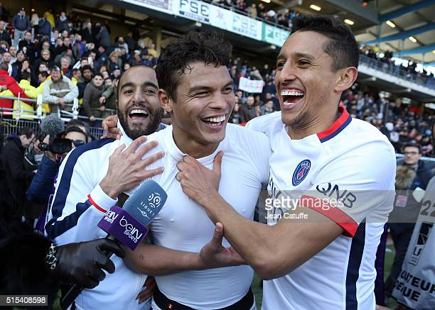 Lucas Moura, Thiago Silva and Marquinhos celebrate winning the French League 1 championships 2015-1016 following the French Ligue 1 match between...