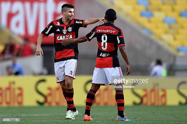 Lucas Mugni and Marcio Araujo of Flamengo celebrate a scored goal against Coritiba during a match between Flamengo and Coritiba as part of...