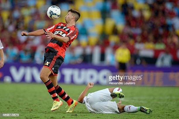 Lucas Mugni of Flamengo battles for the ball with of player of Fluminense during the match between Fluminense and Flamengo as part of Brasileirao...