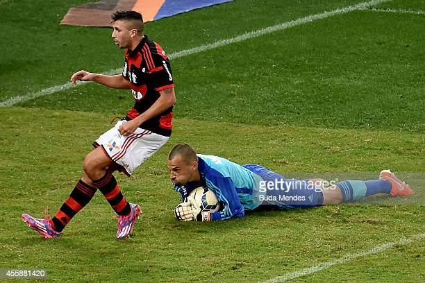 Lucas Mugni of Flamengo struggles for the ball with goalkeeper Diego Cavalieri of Fluminense during a match between Flamengo and Fluminense as part...
