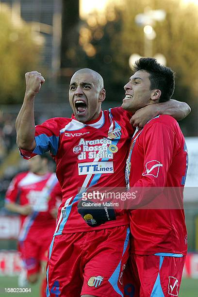 Lucas Nahuel Castro and Sergio Bernardo Almiron of Calcio Catania celebrates after scoring a goal during the Serie A match between AC Siena and...