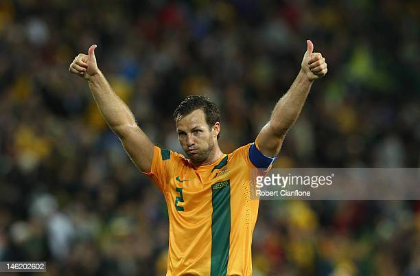 Lucas Neil of Australia acknowledges the fans after Australia drew with Japan at the FIFA World Cup Asian Qualifier match between the Australian...