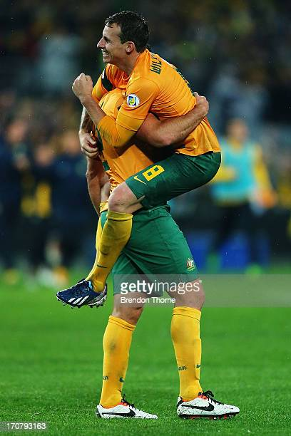 Lucas Neill and Luke Wilkshere of Australia celebrate at full time after victory over Iraq during the FIFA 2014 World Cup Asian Qualifier match...