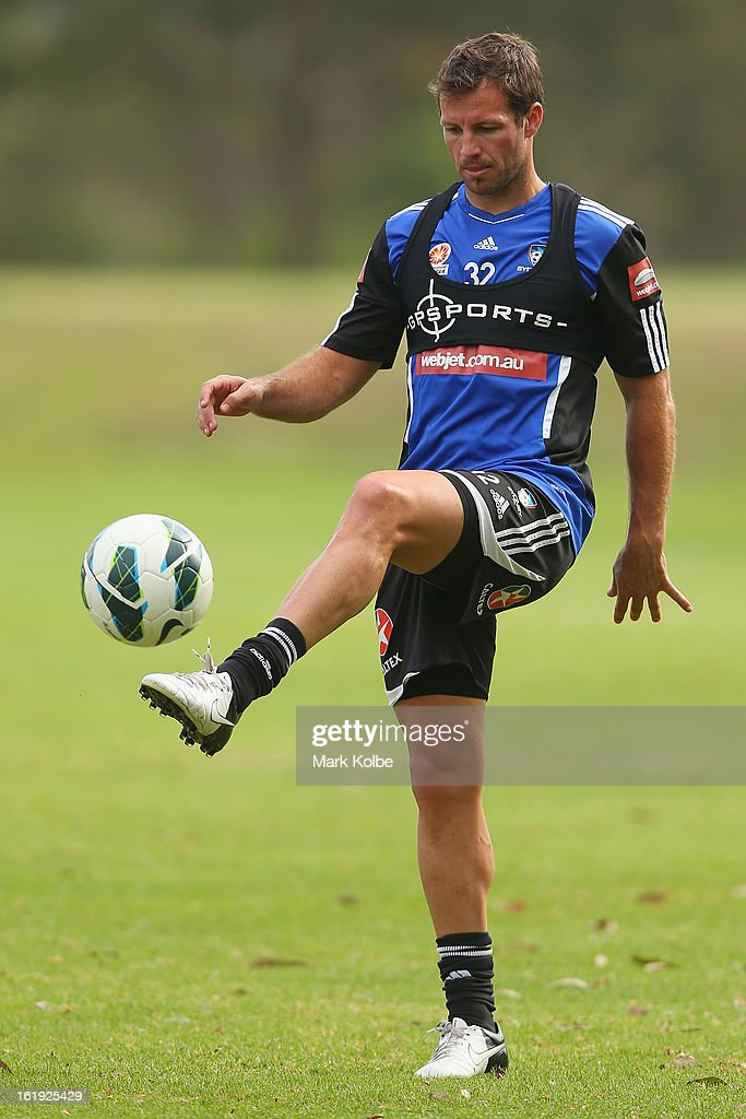 Lucas Neill kicks during a Sydney FC A-League training session at Macquarie Uni on February 18, 2013 in Sydney, Australia.