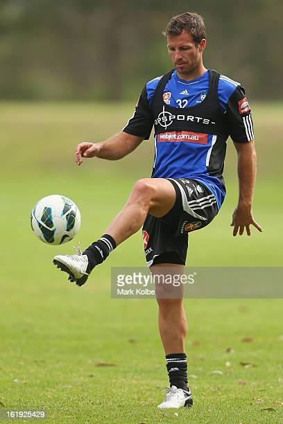 Lucas Neill kicks during a Sydney FC ALeague training session at Macquarie Uni on February 18 2013 in Sydney Australia