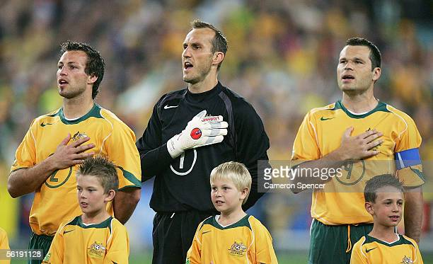 Lucas Neill, Mark Schwarzer, and Mark Viduka of the Socceroos sing the national anthem prior to the second leg of the 2006 FIFA World Cup qualifying...