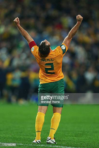 Lucas Neill of Australia celebrates at full time after victory over Iraq during the FIFA 2014 World Cup Asian Qualifier match between the Australian...