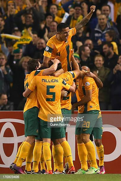 Lucas Neill of Australia is congratulated by team mates after scoring a goal during the FIFA World Cup Qualifier match between the Australian...