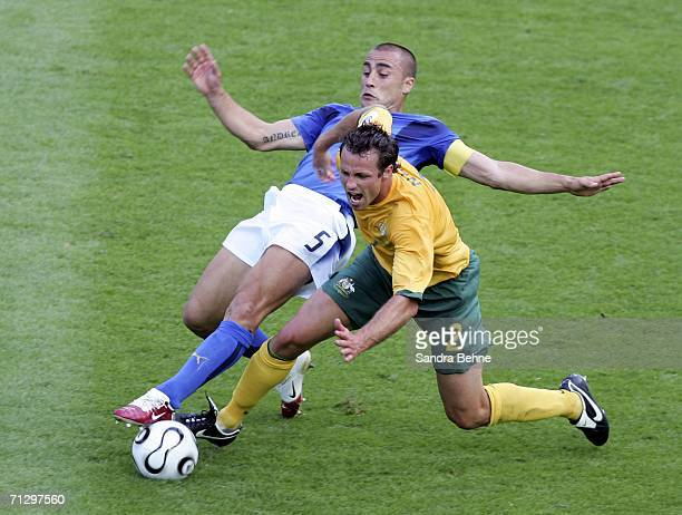 Lucas Neill of Australia is tackled by Fabio Cannavaro of Italy during the FIFA World Cup Germany 2006 Round of 16 match between Italy and Australia...