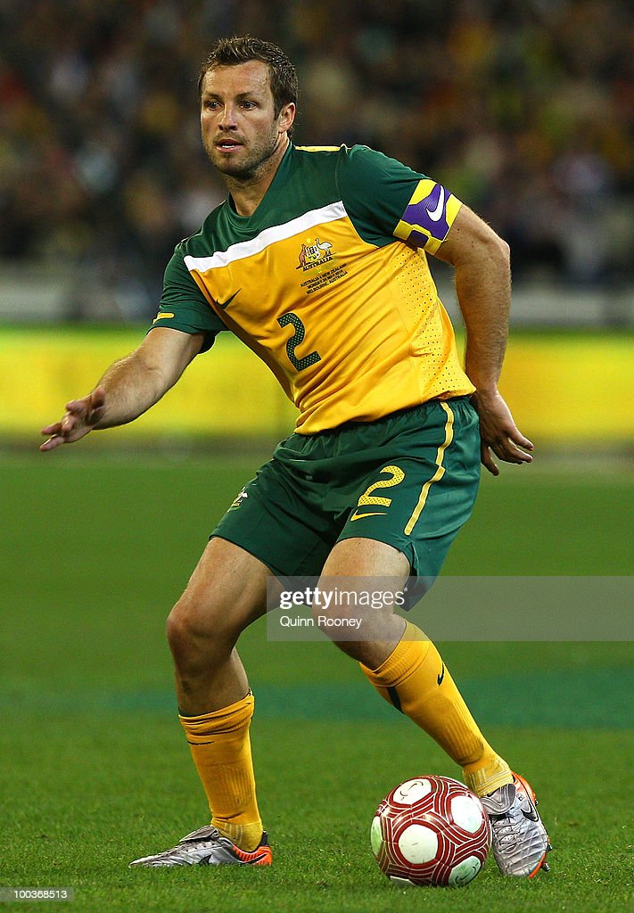 Lucas Neill of Australia passes the ball during the 2010 FIFA World Cup Pre-Tournament match between the Australian Socceroos and the New Zealand All Whites at Melbourne Cricket Ground on May 24, 2010 in Melbourne, Australia.