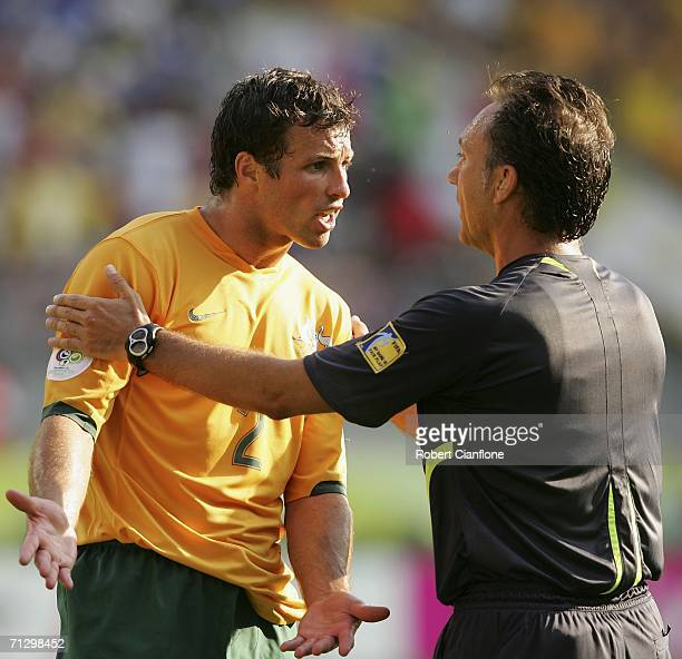 Lucas Neill of Australia remonstrates with Referee Luis Medina Cantalejo of Spain during the FIFA World Cup Germany 2006 Round of 16 match between...