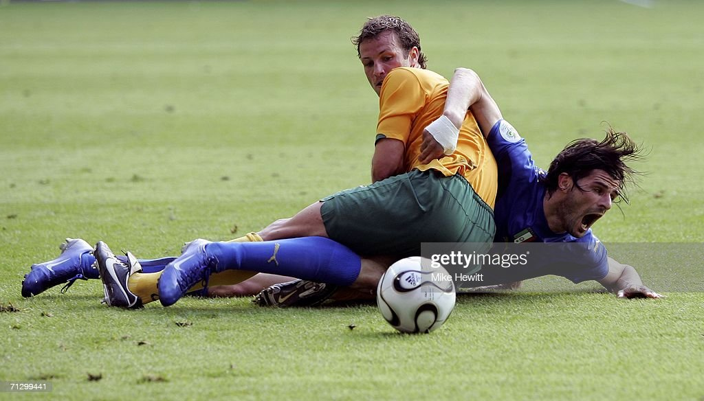 Lucas Neill of Australia tangles with Vincenzo Iaquinta of Italy during the FIFA World Cup Germany 2006 Round of 16 match between Italy and Australia at the Fritz-Walter Stadium on June 26, 2006 in Kaiserslautern, Germany.