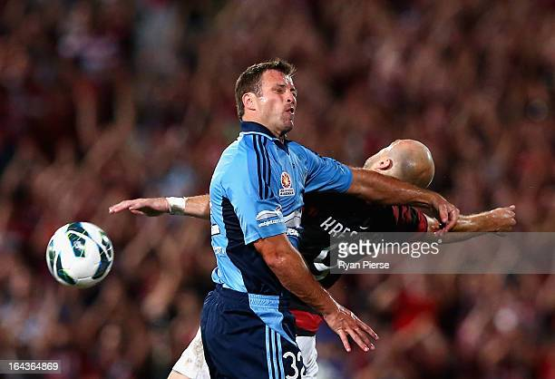 Lucas Neill of Sydney FC competes for the ball against Dino Kresinger of the Wanderers during the round twenty six ALeague match between the Western...