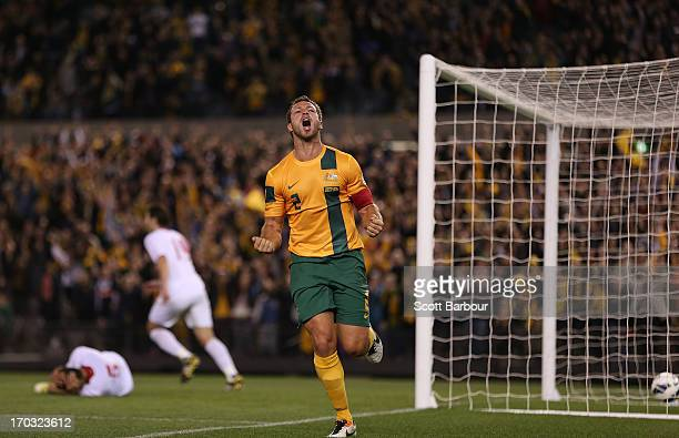 Lucas Neill of the Socceroos celebrates after scoring a goal during the FIFA World Cup Qualifier match between the Australian Socceroos and Jordan at...