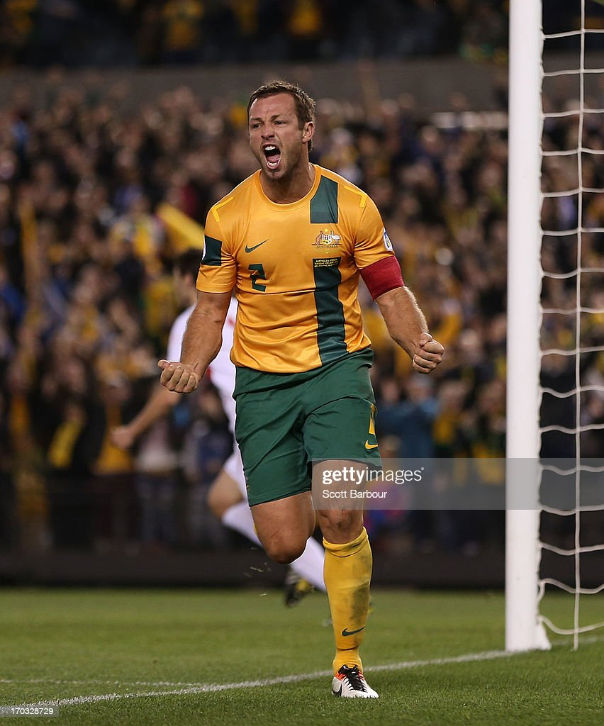 Lucas Neill of the Socceroos celebrates after scoring a goal during the FIFA World Cup Qualifier match between the Australian Socceroos and Jordan at Etihad Stadium on June 11, 2013 in Melbourne, Australia.