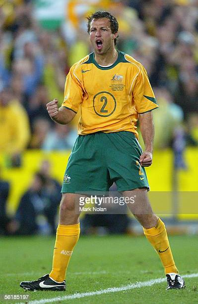 Lucas Neill of the Socceroos celebrates scoring in the penalty shootout during the second leg of the 2006 FIFA World Cup qualifying match between...
