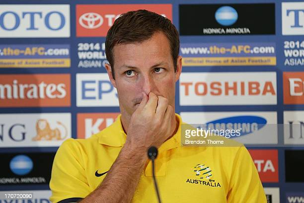 Lucas Neill speaks during an Australian Socceroos press conference at the InterContinental Hotel on June 17 2013 in Sydney Australia