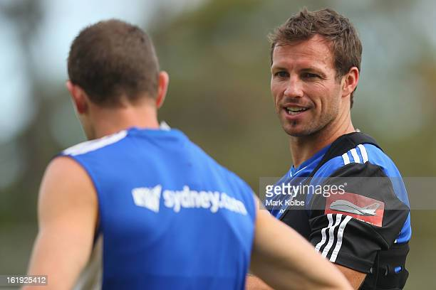 Lucas Neill speaks to a team mate during a Sydney FC ALeague training session at Macquarie Uni on February 18 2013 in Sydney Australia