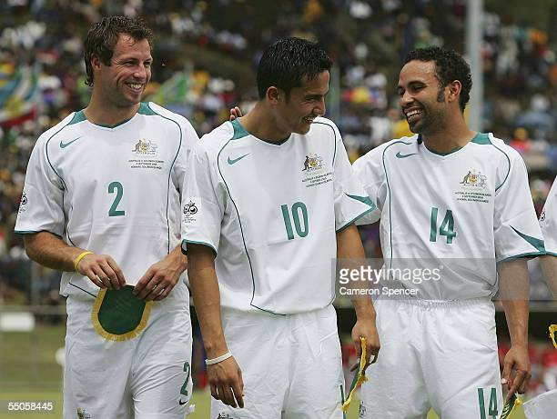 Lucas Neill Tim Cahill and Archie Thompson share a joke prior to the FIFA World Cup Qualifying match between the Australian Socceroos and the Solomon...